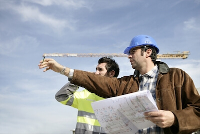 men directing on building site